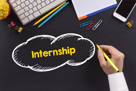 internship: Man working on desk and writing Internship