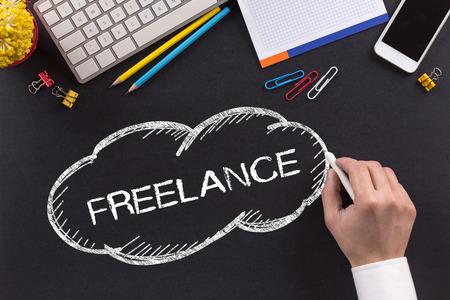 freelance: FREELANCE written on Chalkboard Stock Photo