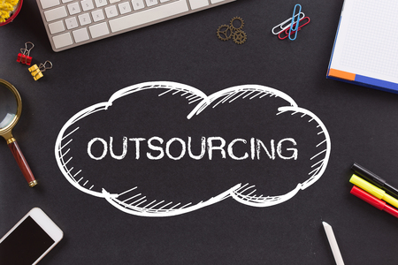 offshoring: OUTSOURCING written on Chalkboard