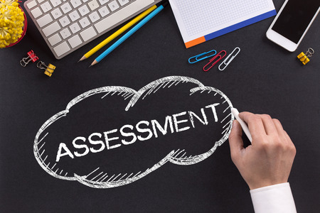 assessment system: ASSESSMENT written on Chalkboard