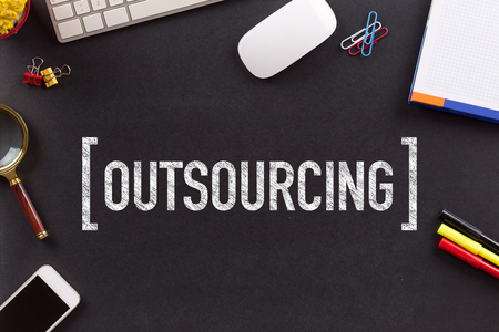 outsourcing: OUTSOURCING CONCEPT ON BLACKBOARD Stock Photo