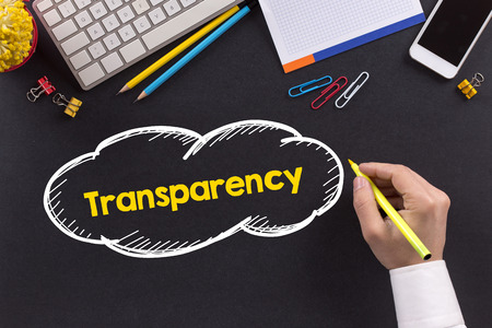 compliant: Man working on desk and writing Transparency Stock Photo