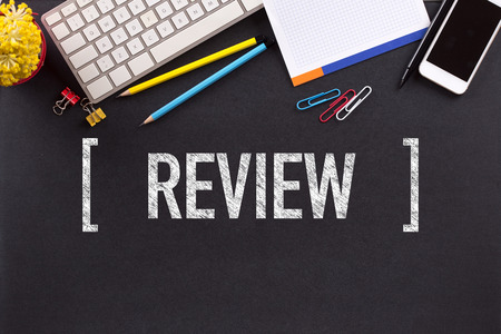 review: REVIEW CONCEPT ON BLACKBOARD Stock Photo