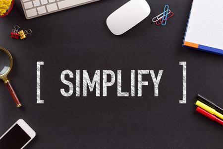 straightforward: SIMPLIFY CONCEPT ON BLACKBOARD Stock Photo