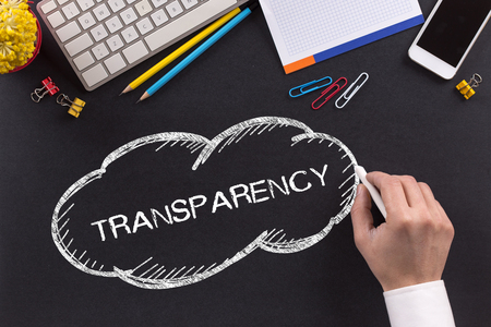 comply: TRANSPARENCY written on Chalkboard Stock Photo