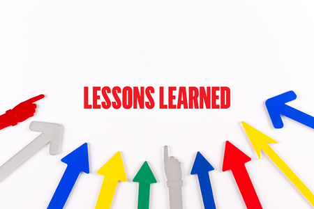 summarize: Colorful Arrows Showing to Center with a word LESSONS LEARNED Stock Photo