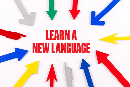 fluency: Colorful Arrows Showing to Center with a word LEARN A NEW LANGUAGE Stock Photo