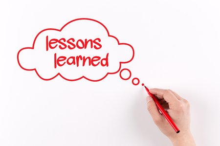 encapsulate: Hand writing Lessons learned on white paper, View from above