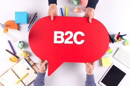 b2c: Two people holding speech bubble with B2C concept Stock Photo