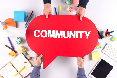 altogether: Two people holding speech bubble with COMMUNITY concept