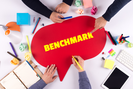 benchmark: TEAMWORK BUSINESS BRAINSTORM BENCHMARK CONCEPT Stock Photo