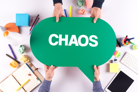 chaos: Two people holding speech bubble with CHAOS concept Stock Photo