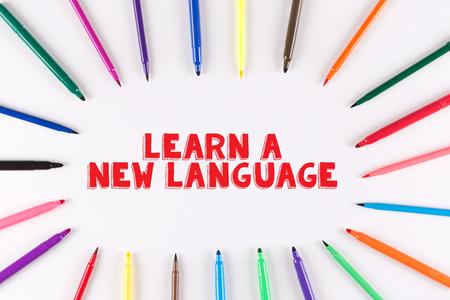 multi colored: EDUCATION CONCEPT: Multi Colored Pen written LEARN A NEW LANGUAGE Stock Photo