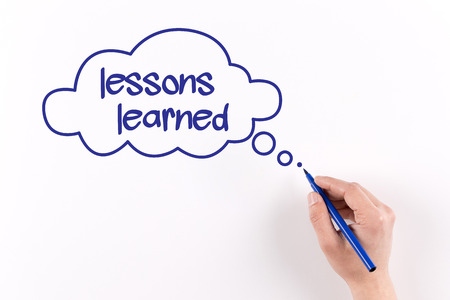 learned: Hand writing Lessons learned on white paper, View from above