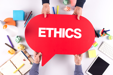 work ethic responsibilities: Two people holding speech bubble with ETHICS concept