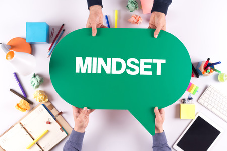 mindset: Two people holding speech bubble with MINDSET concept Stock Photo