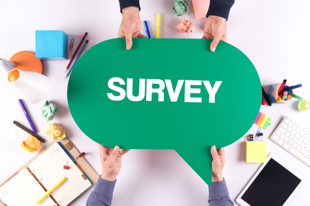 Two people holding speech bubble with SURVEY concept Stok Fotoğraf