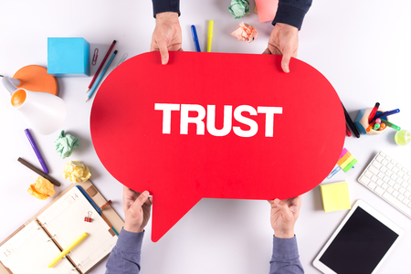 trust people: Two people holding speech bubble with TRUST concept Stock Photo