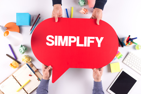pragmatic: Two people holding speech bubble with SIMPLIFY concept