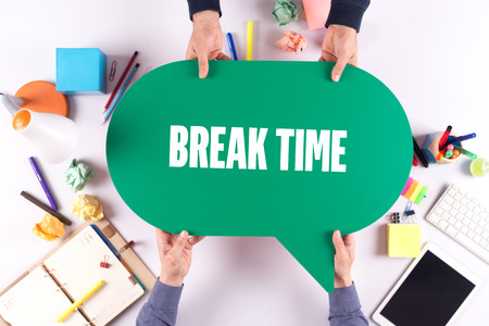 over worked: Two people holding speech bubble with BREAK TIME concept Stock Photo