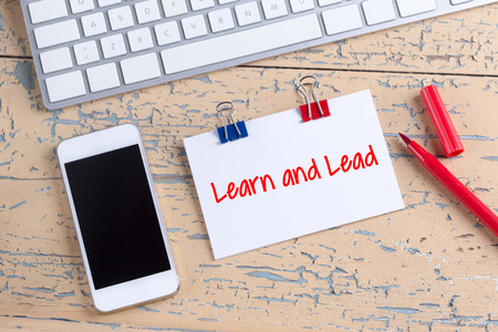 learn and lead: Paper note with text Learn and Lead Stock Photo