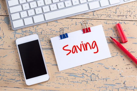 frugality: Paper note with text Saving Stock Photo