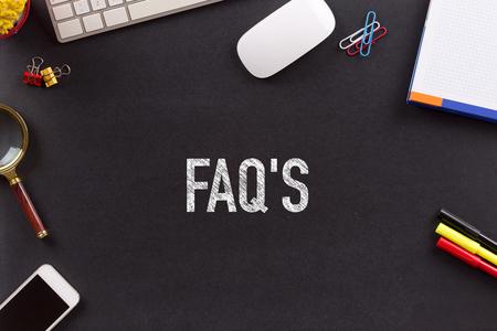 faqs: FAQS CONCEPT ON BLACKBOARD Stock Photo