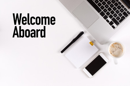 aboard: Welcome Aboard text on the desk with copy space