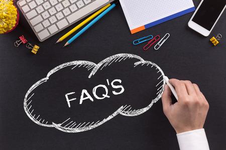 faqs: FAQS written on Chalkboard