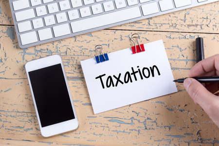 exemption: Paper note with text Taxation