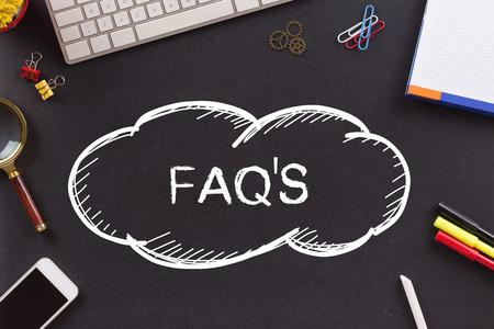 FAQ'S written on Chalkboard