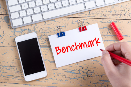 benchmark: Paper note with text Benchmark