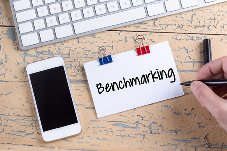 benchmarking: Paper note with text Benchmarking Stock Photo