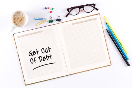 Get Out Of Debt text on notebook with copy space Stock Photo
