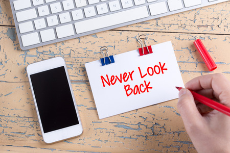 forthcoming: Paper note with text Never Look Back