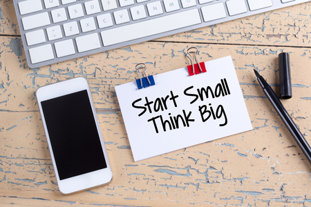 surpass: Paper note with text Start Small Think Big Stock Photo