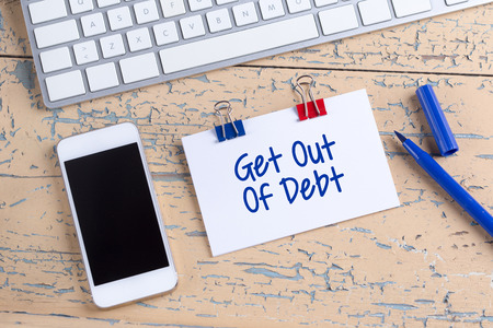 trouble free: Paper note with text Get Out Of Debt Stock Photo