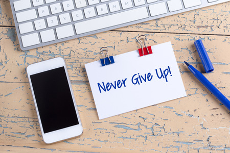 failed attempt: Paper note with text Never Give Up!