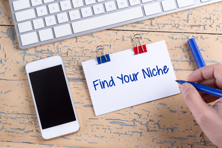specialize: Paper note with text Find Your Niche Stock Photo