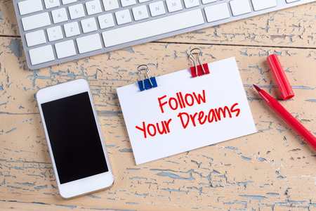 motivator: Paper note with text Follow Your Dreams