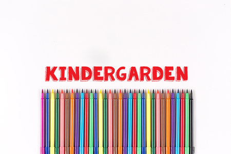 kindergarden: Multicolored felt pens isolated on white with KINDERGARDEN word