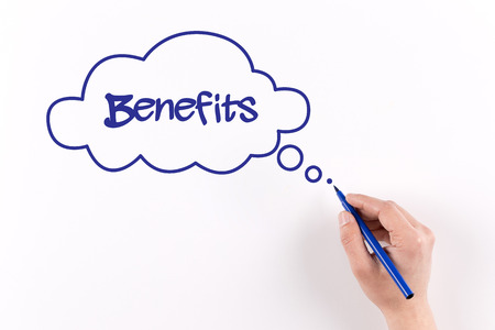 Hand writing Benefits on white paper, View from above