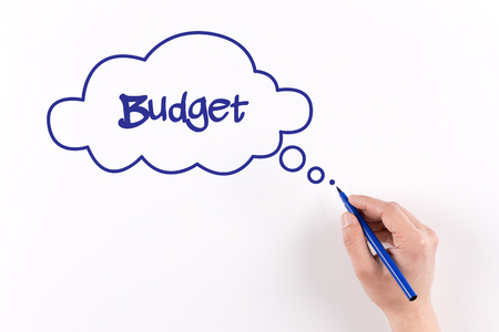 deficit target: Hand writing Budget on white paper, View from above Stock Photo