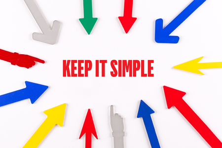 cogent: Colorful Arrows Showing to Center with a word KEEP IT SIMPLE Stock Photo