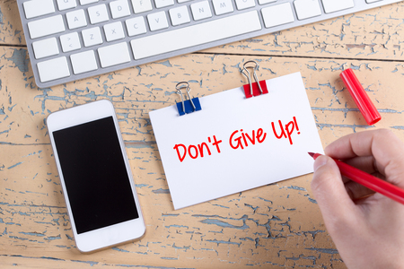 not give: Paper note with text Dont Give Up! Stock Photo