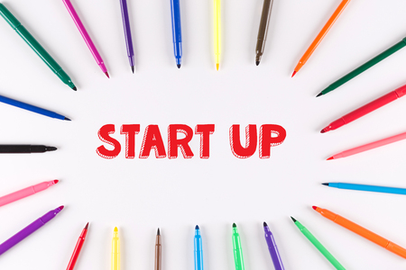 multi colored: Multi Colored Pen written START UP Stock Photo