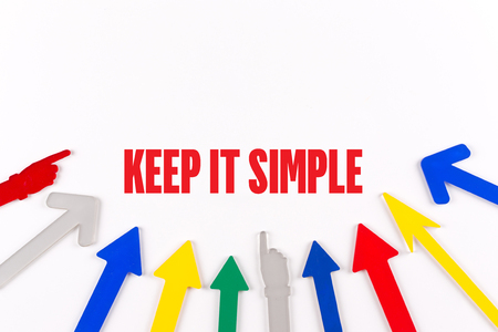 straightforward: Colorful Arrows Showing to Center with a word KEEP IT SIMPLE Stock Photo