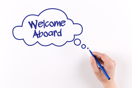 aboard: Hand writing Welcome Aboard on white paper, View from above