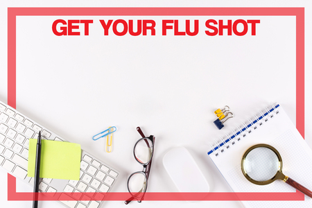swine flu vaccinations: High Angle View of Various Office Supplies on Desk with a word GET YOUR FLU SHOT Stock Photo