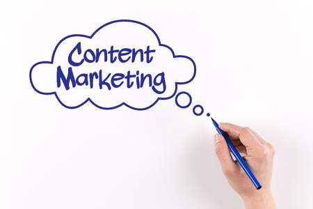 content writing: Hand writing Content Marketing on white paper, View from above Stock Photo